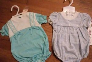 Two never been used vintage baby clothes